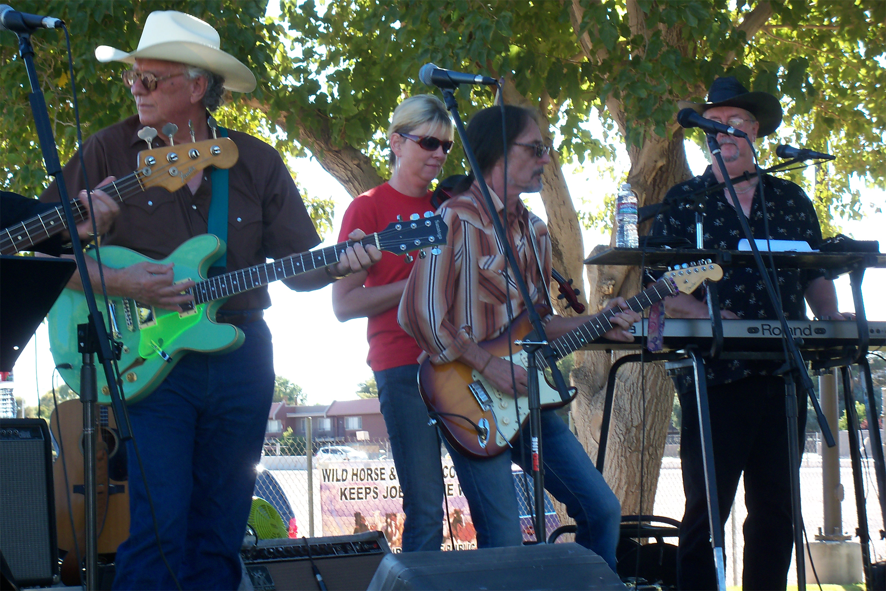 """Grey Beard Bandit performing """"Wild Horses Need Our Voices"""" live at wild horse rally in Las Vegan, Nevada on October 11, 2010. Credit: The Horse Fund. (click to enlarge)."""