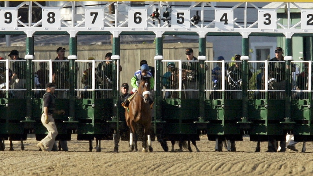 Barbaro breaks through the starting gate, and the race had to be started over.